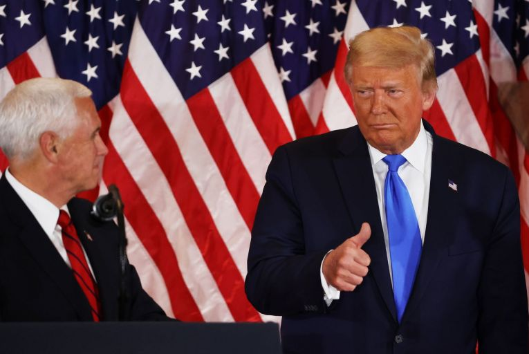 President Donald Trump gestures to his vice-president Mike Pence on election night last Tuesday.