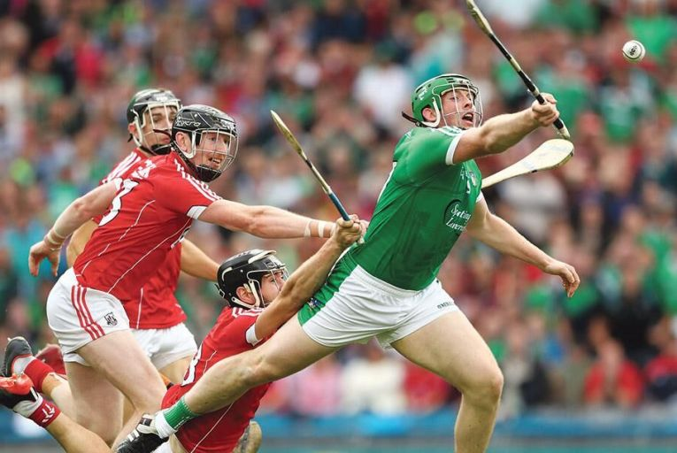 Shane Dowling of Limerick is brought down for a penalty against Cork in last month's semi-final Pic: INPHO/James Crombie