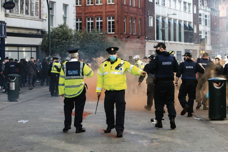 Gardaí on Grafton Street during an anti-lockdown protest in February Pic: RollingNews.ie