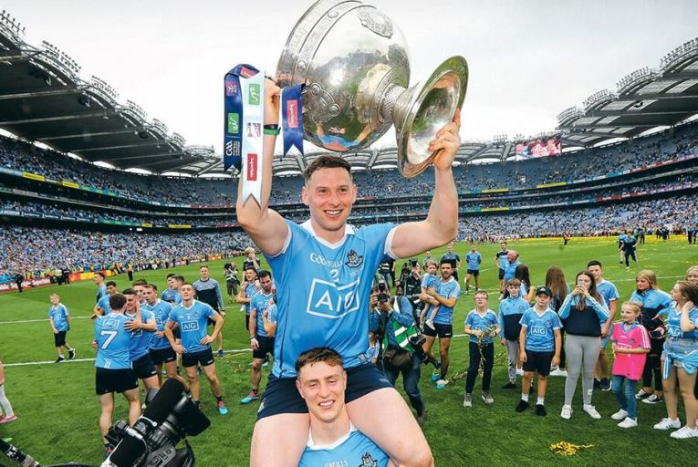 Dublin's Philly McMahon, top, and John Small celebrate with the Sam Maguire trophy Pic: INPHO/Ryan Byrne