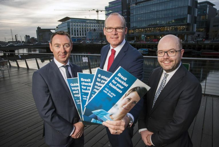 Repro Free Pictured at the Bank of Ireland 'Get to Grips with Brexit' event in the Clarion Hotel, Cork where 200 local businesses gathered to discuss the challenges Brexit poses and how Irish businesses can best prepare themselves were (L-R)  Richie O'Flynn, Commercial Director of South Coast Logistics; Tanaiste Simon Coveney; and Oliver Wall, Chief of Staff and Head of Corporate Affairs, Bank of Ireland. Pic Daragh Mc Sweeney/Provision