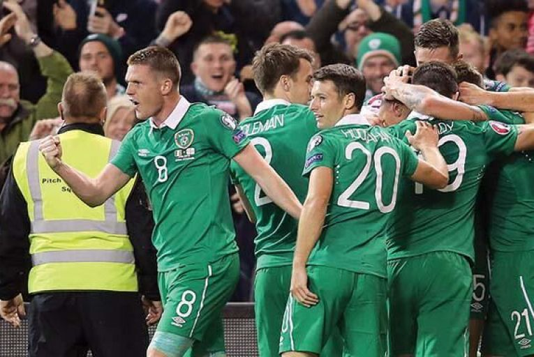 Ireland players celebrate after Jonathan  Walters (hidden) scored against Georgia last Monday evening at the Aviva Picture: Getty