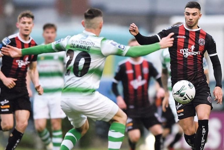 All to play for: Daniel Mandroiu of Bohemians and Trevor Clarke of Shamrock Rovers during a recent SSE Airtricity League Premier Division match between Bohemians and Shamrock Rovers at Dalymount Park in Dublin. The teams could yet find themselves playing in a 32-county league. PIc: Getty Images