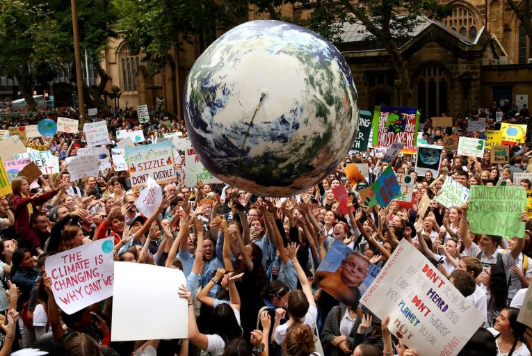 A climate change awareness rally in Sydney in 2019: Facing climate change squarely requires accepting harsh realities, such as the need to set strict limits on consumption, pollution and emissions. Picture: Don Arnold/Getty Images