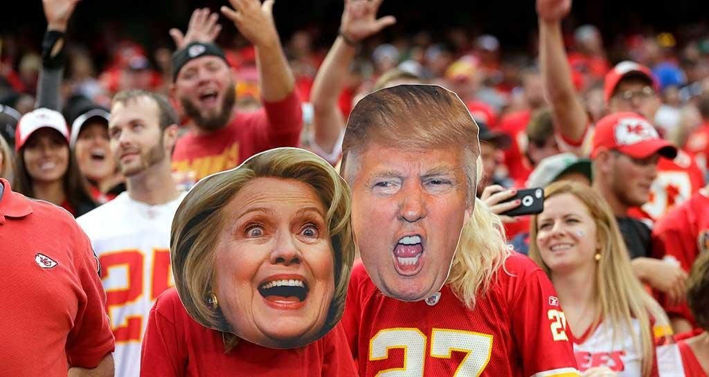 American football fans wear Hillary Clinton and Donald Trump masks ahead of tonight's US presidential debate Pic: Getty