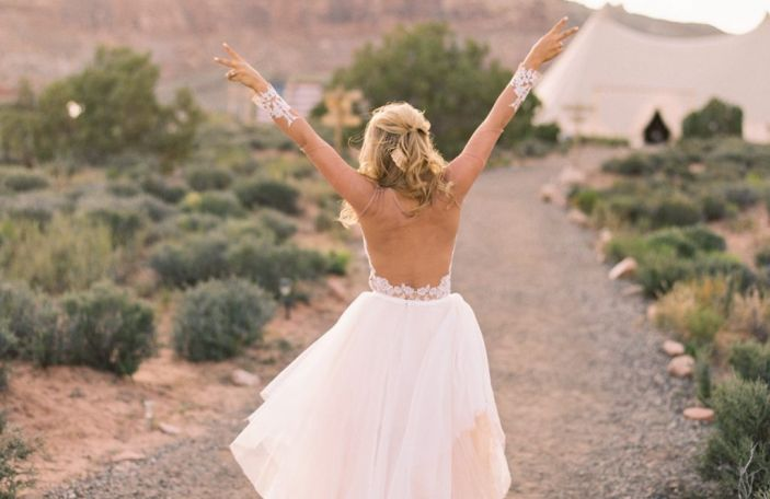 Wedchella - Chloe and Taylor's festival-themed wedding shot by Laura Goldenberger