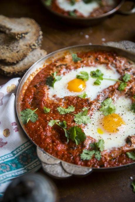 Harissa Baked Eggs | DonalSkehan.com, Enjoy this healthy, comforting baked egg recipe for breakfast, brunch, lunch or dinner.