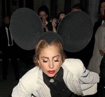 Lady Gaga struts in Philip Treacy at LFW