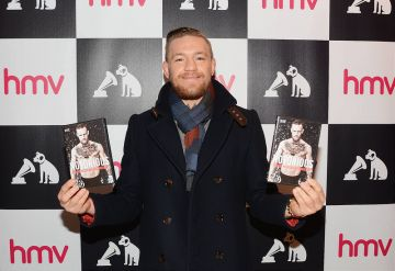Conor McGregor signs copies of his DVD documentary 'Notorious' at HMV