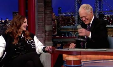 Watch: Montage of Julia Roberts' 26 stints on Letterman. Nails him as a person. Gives him a smacker