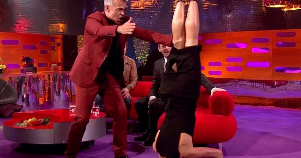 Watch: Amanda Holden's epic headstand on Graham Norton