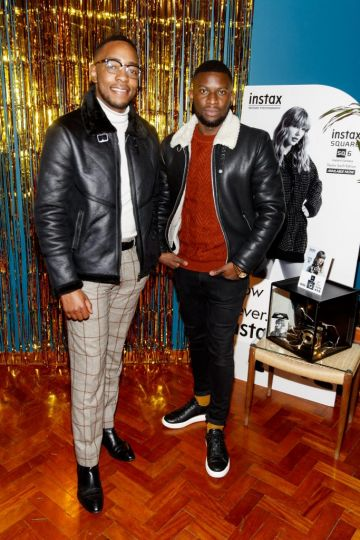 Lawson Mpame and Itchey Drew pictured at the instax Christmas party that showcased the perfect selection of must-have gifts. Picture Andres Poveda