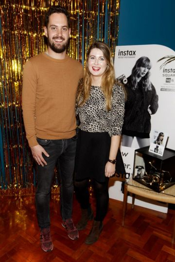 Kevin Meighan and Hannah Popham pictured at the instax Christmas party that showcased the perfect selection of must-have gifts. Picture Andres Poveda