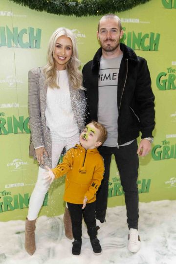 Rosie Connolly and Paul Quinn with Harry (3) pictured at the Irish premiere screening of The Grinch at ODEON Point Village, Dublin. Picture Andres Poveda