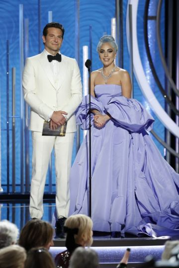 Presenters  Bradley Cooper and Lady Gaga  speak onstage during the 76th Annual Golden Globe Awards at The Beverly Hilton Hotel on January 06, 2019 in Beverly Hills, California.  (Photo by Paul Drinkwater/NBCUniversal via Getty Images)