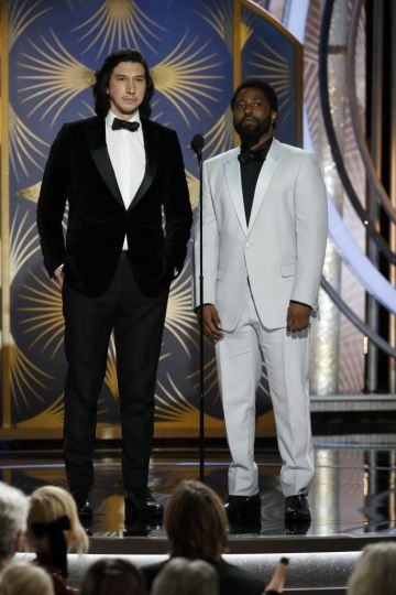 Presenters Adam Driver and John David Washington speak onstage during the 76th Annual Golden Globe Awards at The Beverly Hilton Hotel on January 06, 2019 in Beverly Hills, California.  (Photo by Paul Drinkwater/NBCUniversal via Getty Images)