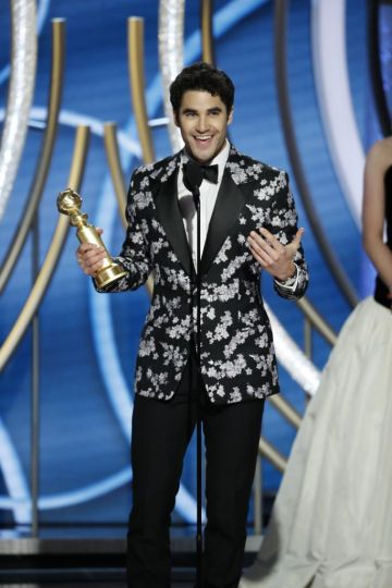 "Darren Criss from ""The Assassination of Gianni Versace: American Crime Story"" accepts the Best Performance by an Actor in a Limited Series or Motion Picture Made for Television award onstage during the 76th Annual Golden Globe Awards at The Beverly Hilton Hotel on January 06, 2019 in Beverly Hills, California.  (Photo by Paul Drinkwater/NBCUniversal via Getty Images)"