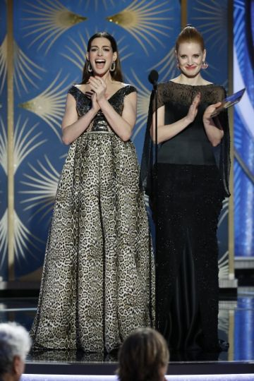Presenters Anne Hathaway and Jessica Chastain  speak onstage during the 76th Annual Golden Globe Awards at The Beverly Hilton Hotel on January 06, 2019 in Beverly Hills, California.  (Photo by Paul Drinkwater/NBCUniversal via Getty Images)