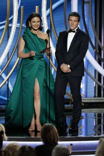 Presenters Catherine Zeta-Jones and Antonio Banderas speak onstage during the 76th Annual Golden Globe Awards at The Beverly Hilton Hotel on January 06, 2019 in Beverly Hills, California.  (Photo by Paul Drinkwater/NBCUniversal via Getty Images)