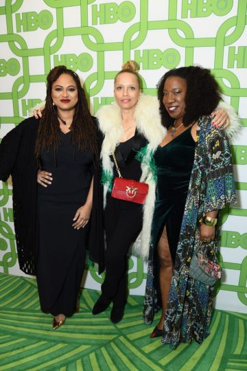 Ava DuVernay, a guest, and Tarana Burke attend HBO's Official Golden Globe Awards After Party at Circa 55 Restaurant on January 6, 2019 in Los Angeles, California.  (Photo by Presley Ann/Getty Images)