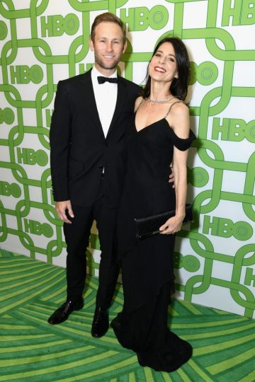 Aaron Endress-Fox (L) and Perrey Reeves attend HBO's Official Golden Globe Awards After Party at Circa 55 Restaurant on January 6, 2019 in Los Angeles, California.  (Photo by Presley Ann/Getty Images)