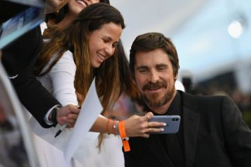 LOS ANGELES, CA - JANUARY 27:  Christian Bale poses with a fan at the 25th Annual Screen Actors Guild Awards at The Shrine Auditorium on January 27, 2019 in Los Angeles, California. 480543  (Photo by Mike Coppola/Getty Images for Turner)