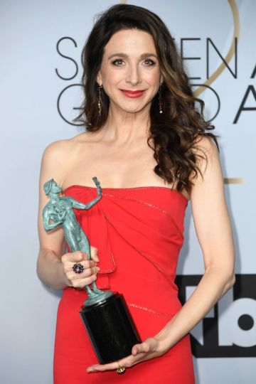 LOS ANGELES, CA - JANUARY 27:  Marin Hinkle, winner of Outstanding Performance by an Ensemble in a Comedy Series for 'The Marvelous Mrs. Maisel,' poses in the press room during the 25th Annual Screen ActorsGuild Awards at The Shrine Auditorium on January 27, 2019 in Los Angeles, California.  (Photo by Frazer Harrison/Getty Images)