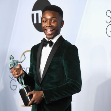 LOS ANGELES, CA - JANUARY 27:  Niles Fitch, winner of Outstanding Performance by an Ensemble in a Drama Series for 'This Is Us,' poses in the press room during the 25th Annual Screen ActorsGuild Awards at The Shrine Auditorium on January 27, 2019 in Los Angeles, California.  (Photo by Frazer Harrison/Getty Images)