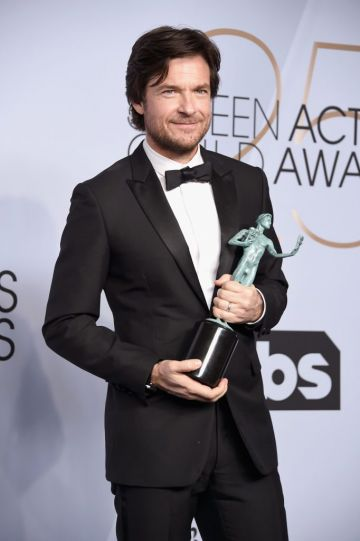 LOS ANGELES, CA - JANUARY 27:  Jason Bateman poses in the press room with award for Outstanding Performance by a Male Actor in a Drama Series in 'Ozark' during the 25th Annual Screen ActorsGuild Awards at The Shrine Auditorium on January 27, 2019 in Los Angeles, California. 480645  (Photo by Gregg DeGuire/Getty Images for Turner)