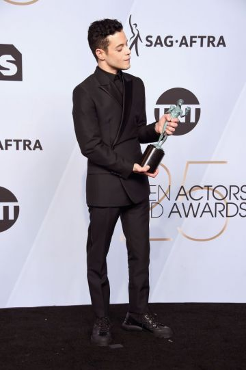 LOS ANGELES, CA - JANUARY 27:  Rami Malek poses in the press room with award for Outstanding Performance by a Male Actor in a Leading Role in 'Bohemian Rhapsody' during the 25th Annual Screen ActorsGuild Awards at The Shrine Auditorium on January 27, 2019 in Los Angeles, California. 480645  (Photo by Gregg DeGuire/Getty Images for Turner)