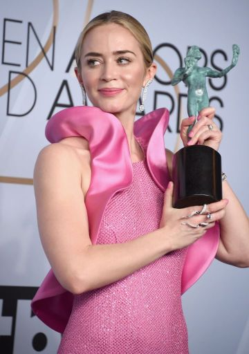 LOS ANGELES, CA - JANUARY 27:  Emily Blunt poses in the press room with award for Outstanding Performance by a Female Actor in a Supporting Role in 'A Quiet Place' during the 25th Annual Screen ActorsGuild Awards at The Shrine Auditorium on January 27, 2019 in Los Angeles, California. 480645  (Photo by Gregg DeGuire/Getty Images for Turner)