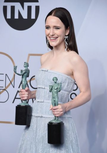 LOS ANGELES, CA - JANUARY 27:  Rachel Brosnahan poses in the press room with awards for Outstanding Performance by a Female Actor in a Comedy Series and Outstanding Performance by an Ensemble in a Comedy Series in The Marvelous Mrs. Maisel during the 25th Annual Screen ActorsGuild Awards at The Shrine Auditorium on January 27, 2019 in Los Angeles, California. 480645  (Photo by Gregg DeGuire/Getty Images for Turner)