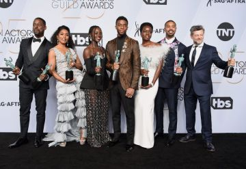 LOS ANGELES, CA - JANUARY 27:  (L-R) Sterling K. Brown, Angela Bassett, Lupita Nyong'o, Chadwick Boseman, Danai Gurira, Michael B. Jordan, and Andy Serkis pose in the press room with awards for Outstanding Performance by a Cast in a Motion Picture in 'Black Panther' during the 25th Annual Screen ActorsGuild Awards at The Shrine Auditorium on January 27, 2019 in Los Angeles, California. 480645  (Photo by Gregg DeGuire/Getty Images for Turner)