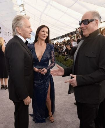 LOS ANGELES, CA - JANUARY 27: (L-R) Michael Douglas, Catherine Zeta-Jones and Andrew Dice Clay attend the 25th Annual Screen Actors Guild Awards at The Shrine Auditorium on January 27, 2019 in Los Angeles, California.  (Photo by Presley Ann/Getty Images)