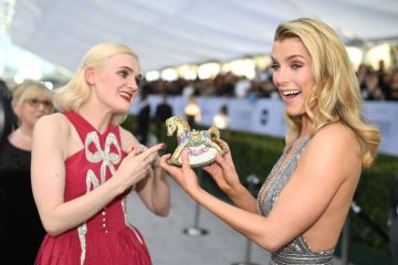 Actresses Betty Gilpin (R) and Gayle Rankin walk the red carpet at the 25th Annual Screen Actors Guild Awards at the Shrine Auditorium in Los Angeles on January 27, 2019. (Photo by Robyn Beck / AFP)        (Photo credit should read ROBYN BECK/AFP/Getty Images)