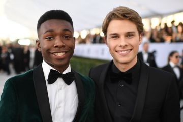 Actor Niles Fitch (L) and Actor Logan Shroyer walk the red carpet at the 25th Annual Screen Actors Guild Awards at the Shrine Auditorium in Los Angeles on January 27, 2019. (Photo by Robyn Beck / AFP)        (Photo credit should read ROBYN BECK/AFP/Getty Images)