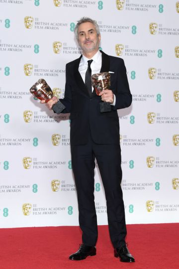 LONDON, ENGLAND - FEBRUARY 10:  Winner of the Best Director and Best Film awards for Roma, director Alfonso Cuaron poses in the press room during the EE British Academy Film Awards at Royal Albert Hall on February 10, 2019 in London, England. (Photo by Pascal Le Segretain/Getty Images)