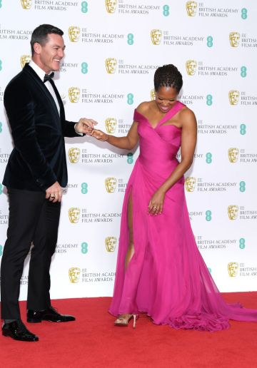 LONDON, ENGLAND - FEBRUARY 10:  Luke Evans (L) and Regina King pose in the press room during the EE British Academy Film Awards at Royal Albert Hall on February 10, 2019 in London, England. (Photo by Pascal Le Segretain/Getty Images)