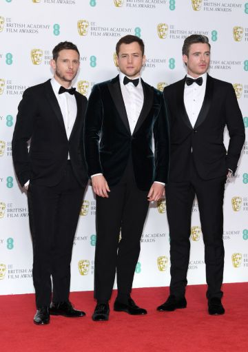 LONDON, ENGLAND - FEBRUARY 10:  (L-R) Jamie Bell, Taron Egerton and Richard Madden pose in the press room during the EE British Academy Film Awards at Royal Albert Hall on February 10, 2019 in London, England. (Photo by Pascal Le Segretain/Getty Images)