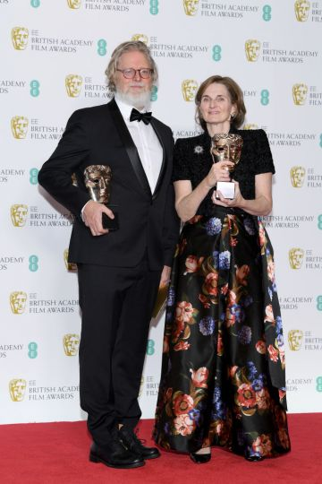 LONDON, ENGLAND - FEBRUARY 10:  Winners of Original Screenplay award for The Favourite, Tony McNamara (L) and Deborah Davis pose in the press room during the EE British Academy Film Awards at Royal Albert Hall on February 10, 2019 in London, England. (Photo by Pascal Le Segretain/Getty Images)