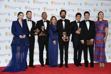 LONDON, ENGLAND - FEBRUARY 10:  (L-R) Presenter Lily Collins with winners of the Animated Film award for Spider-Man: Into the Spider-Verse, directors Rodney Rothman and Peter Ramsey, Christina Steinberg, director Bob Persichetti, screenwriter Phil Lord, Chris Miller and presenter Olga Kurylenko pose the press room during the EE British Academy Film Awards at Royal Albert Hall on February 10, 2019 in London, England. (Photo by Pascal Le Segretain/Getty Images)