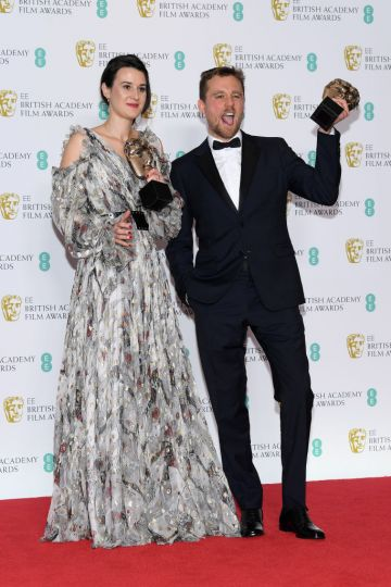 LONDON, ENGLAND - FEBRUARY 10:  Winners of the Outstanding Debut By A British Writer, Director or Producer award, Lauren Dark (L) and Micheal Pearce pose in the press room during the EE British Academy Film Awards at Royal Albert Hall on February 10, 2019 in London, England. (Photo by Pascal Le Segretain/Getty Images)