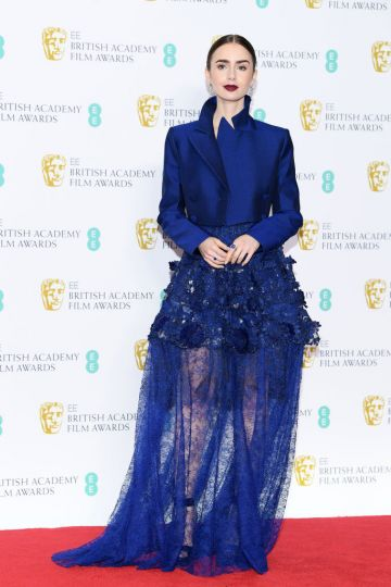 LONDON, ENGLAND - FEBRUARY 10:  Lily Collins poses in the press room during the EE British Academy Film Awards at Royal Albert Hall on February 10, 2019 in London, England. (Photo by Pascal Le Segretain/Getty Images)