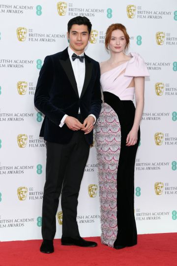 LONDON, ENGLAND - FEBRUARY 10:  Henry Golding (L) and Eleanor Tomlinson pose in the press room during the EE British Academy Film Awards at Royal Albert Hall on February 10, 2019 in London, England. (Photo by Pascal Le Segretain/Getty Images)