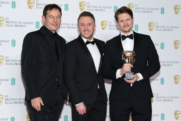 LONDON, ENGLAND - FEBRUARY 10: (L-R) Jason Isaacs, Alex Lockwood and Oliver Walton winners of British Short Film for '73 Cows' in the press room during the EE British Academy Film Awards at Royal Albert Hall on February 10, 2019 in London, England. (Photo by Pascal Le Segretain/Getty Images)