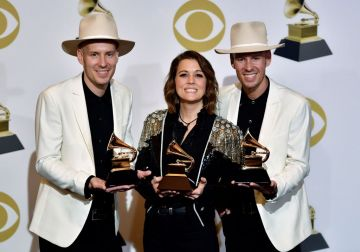 """Singer/songwriter Brandi Carlile (C), with musicians Tim and Phil Hanseroth, poses with her awards for Best American Roots Performance """"The Joke"""", Best American Roots song """"The joke"""" and Best Americana Album """"By the Way, I Forgive You"""" in the press room during the 61st Annual Grammy Awards on February 10, 2019, in Los Angeles. (Photo by FREDERIC J. BROWN / AFP)        (Photo credit should read FREDERIC J. BROWN/AFP/Getty Images)"""