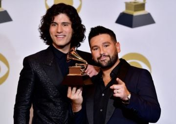 Dan Smyers and Shay Mooney of musical duo Dan + Shay pose with their award for best country duo/group performance in the press room during the 61st Annual Grammy Awards on February 10, 2019, in Los Angeles. (Photo by Frederic J. BROWN / AFP)        (Photo credit should read FREDERIC J. BROWN/AFP/Getty Images)