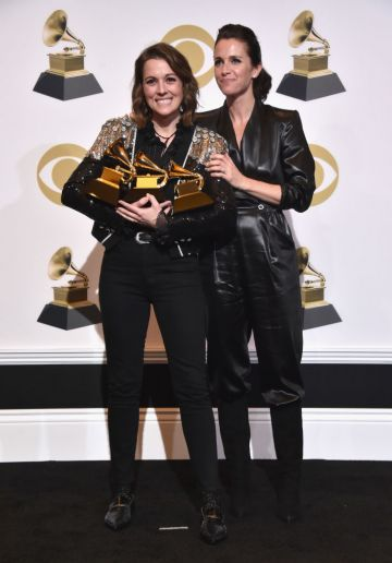 LOS ANGELES, CA - FEBRUARY 10:  Singer/songwriter Brandi Carlile (L), with British actress Catherine Shepherd, poses with her awards for Best American Roots Performance 'The Joke', Best American Roots song 'The joke' and Best Americana Album 'By the Way, I Forgive You' poses in the press room during the 61st Annual GRAMMY Awards at Staples Center on February 10, 2019 in Los Angeles, California.  (Photo by Alberto E. Rodriguez/Getty Images for The Recording Academy)