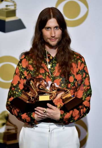 """Sweedish composer Ludwig Goransson poses with the award for Record Of The Year """"This Is America"""" (by Childish Gambino), for Song of the Year (This is America) and Best Score Soundtrack (Black Panther) in the press room during the 61st Annual Grammy Awards on February 10, 2019, in Los Angeles. (Photo by FREDERIC J. BROWN / AFP)        (Photo credit should read FREDERIC J. BROWN/AFP/Getty Images)"""