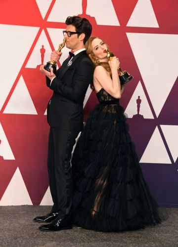 "HOLLYWOOD, CALIFORNIA - FEBRUARY 24: (L-R) Guy Nattiv and Jaime Ray Newman, winners of Best Live Action Short Film for ""Skin,"" pose in the press room during the 91st Annual Academy Awards at Hollywood and Highland on February 24, 2019 in Hollywood, California. (Photo by Frazer Harrison/Getty Images)"